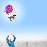 Mulher com balões Fotos de Stock