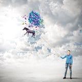 Mulher com balões Fotos de Stock Royalty Free