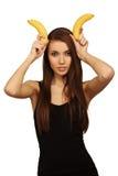 A mulher com bananas imagem de stock