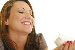 Mulher com banco piggy Fotos de Stock