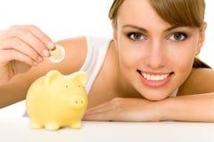 Mulher com banco Piggy Fotografia de Stock Royalty Free