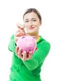 Mulher com banco piggy Imagens de Stock