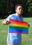 Mulher com a bandeira alegre do orgulho Fotografia de Stock Royalty Free