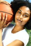 Mulher com basquetebol imagens de stock