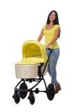 A mulher com bebê e pram isolado no branco Fotos de Stock
