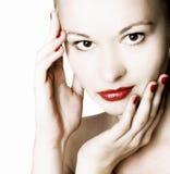 Mulher com bordos vermelhos Fotografia de Stock