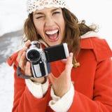 Mulher com câmara de vídeo. Fotos de Stock