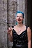 Mulher com cabelo azul e sorriso bonito Fotografia de Stock