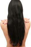 A mulher com cabelo longo está para trás Fotos de Stock Royalty Free