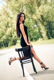 Mulher com cadeira fotos de stock