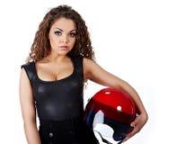 Mulher com capacete do motociclista fotografia de stock