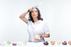 Mulher com cebolas Imagens de Stock