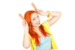 Mulher com cenouras Fotos de Stock