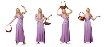 A mulher com a cesta de fruto isolada no branco Imagem de Stock Royalty Free