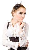 Mulher com chicotes e o espartilho longos Foto de Stock