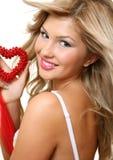 A mulher com coração Fotos de Stock Royalty Free
