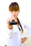 Mulher com de controle remoto Imagem de Stock Royalty Free