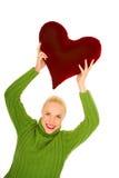 Mulher com descanso heart-shaped imagem de stock royalty free
