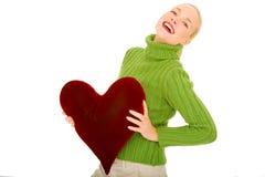 Mulher com descanso heart-shaped foto de stock
