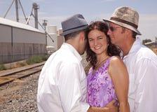 Mulher com dois homens imagens de stock