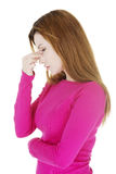 Mulher com dor da pressão da cavidade Foto de Stock