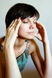 Mulher com dor de cabeça Imagens de Stock