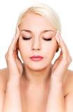 Mulher com dor de cabeça Imagem de Stock