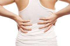 Mulher com dor traseira Imagens de Stock