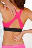 Mulher com dor traseira Fotos de Stock Royalty Free