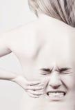 Mulher com dores traseiras fotografia de stock royalty free