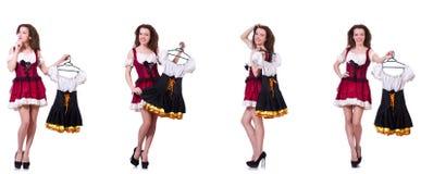 A mulher com escolha difícil de escolher a roupa Fotografia de Stock