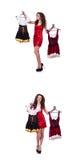 A mulher com escolha difícil de escolher a roupa Fotos de Stock
