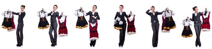 A mulher com escolha difícil de escolher a roupa Imagem de Stock Royalty Free