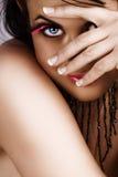 Mulher com esconder das pestanas Imagem de Stock Royalty Free