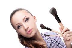 Mulher com escovas da composição fotos de stock