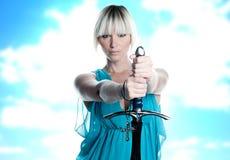 Mulher com espada e cruz foto de stock royalty free