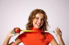 Mulher com fita e maçã Fotografia de Stock