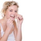 Mulher com floss dental Fotos de Stock Royalty Free