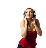 Mulher com fones de ouvido Foto de Stock