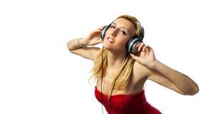 Mulher com fones de ouvido Foto de Stock Royalty Free