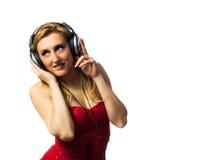 Mulher com fones de ouvido Imagens de Stock Royalty Free
