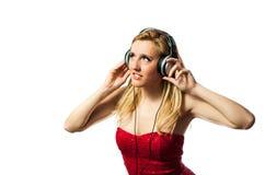 Mulher com fones de ouvido Imagens de Stock
