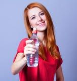 Mulher com garrafa. imagens de stock