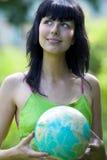 Mulher com global Imagem de Stock