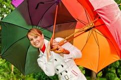 Mulher com guarda-chuvas imagens de stock royalty free
