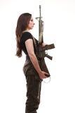Mulher com injetor - mulher do exército com plástico do rifle Foto de Stock