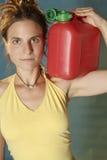Mulher com lata jerry Fotos de Stock Royalty Free