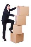 Mulher com lotes das caixas Imagens de Stock