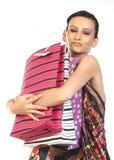 Mulher com lotes de sacos de compra fotografia de stock royalty free