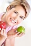 Mulher com maçãs imagem de stock royalty free